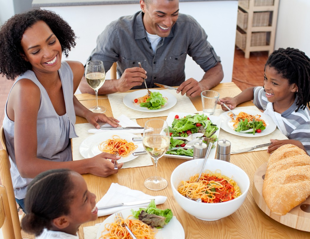 Smiling family dining together