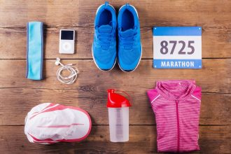 38905920 - various running stuff lined up on a wooden floor background